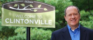 David Leland with Clintonville sign