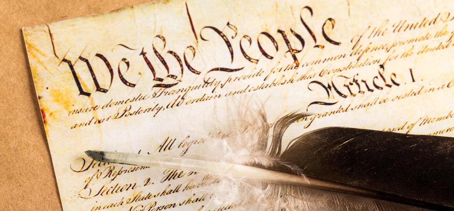 United States Constitution with quill pen