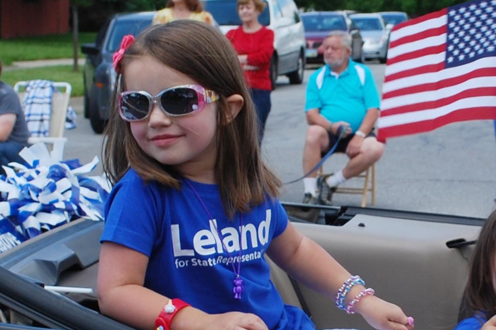 Young Girl In Leland Shirt Riding In The 4th Of July Parade